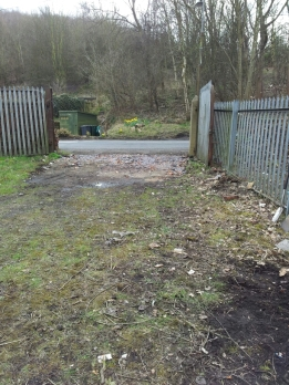 A view of the main site entrance, cleared of stumps and weeds