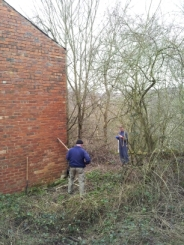 Volunteers clearing brambles at the lower level