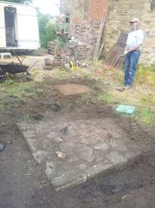 Another iron plate uncovered, photographed, and lifted