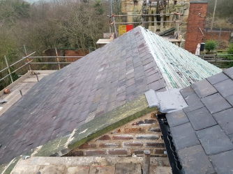 Slate replaced, brickwork repointed