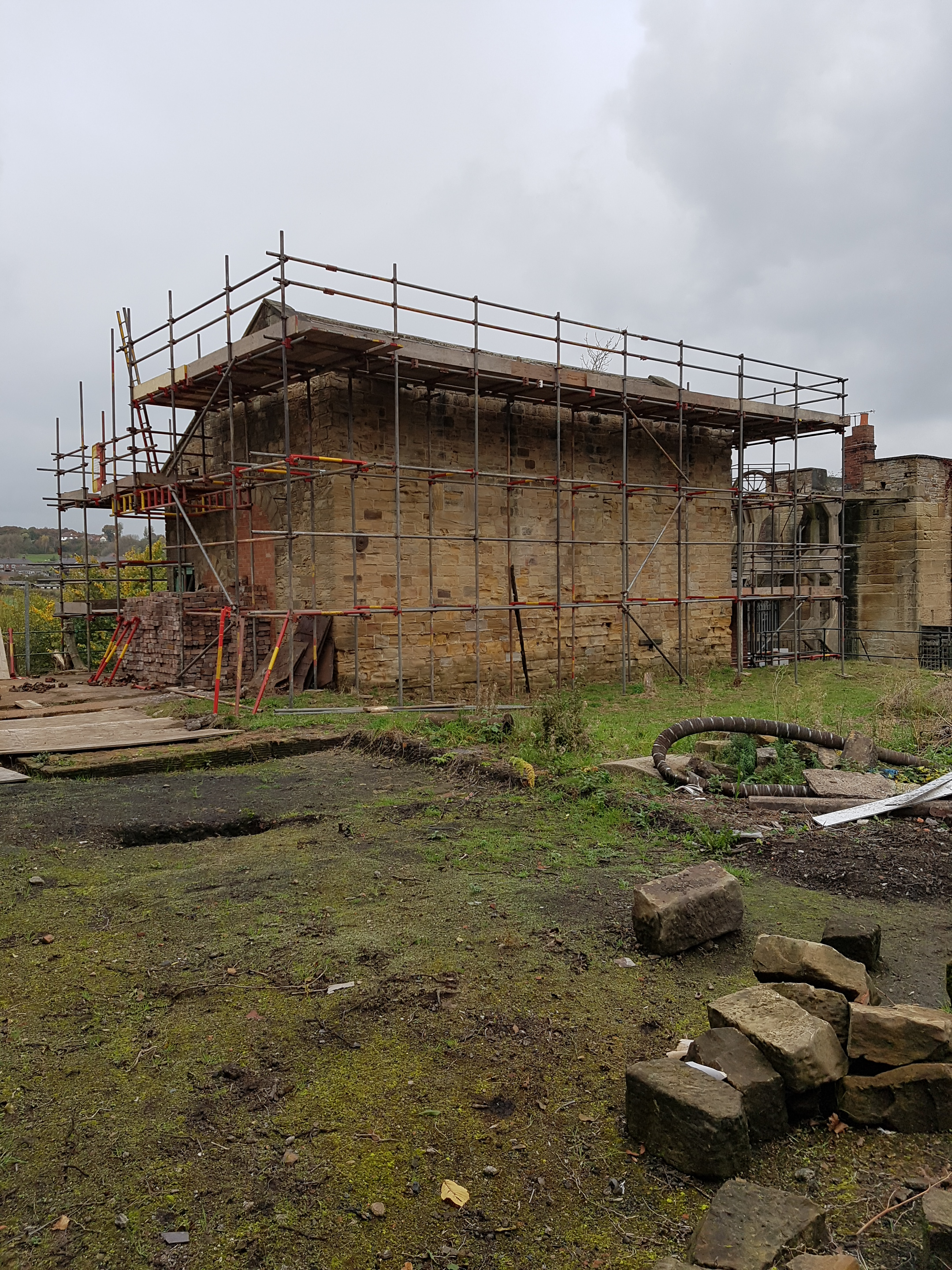 Image of winding engine house before roof restoration (scaffolded and damaged roof)
