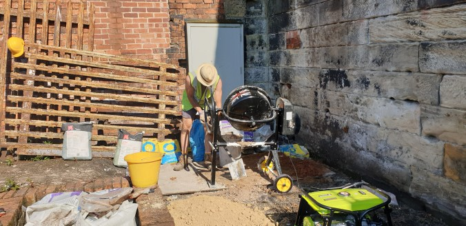 Cement mixer hard at it on lower terrace mixing lime mortar. Cement was also used as a rubble infill binder for collapsed sections