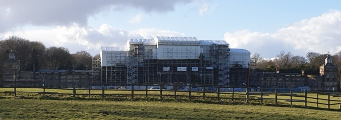 View of the front of Wentworth Woodhouse with the roof covered in scaffold, undergoing repairs in March 2020