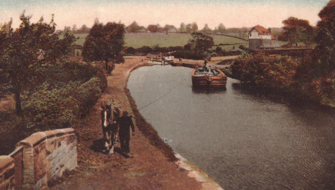 Horse power: a horse draws a barge by rope down the Barnsley Canal (coloured postcard early 20th century)