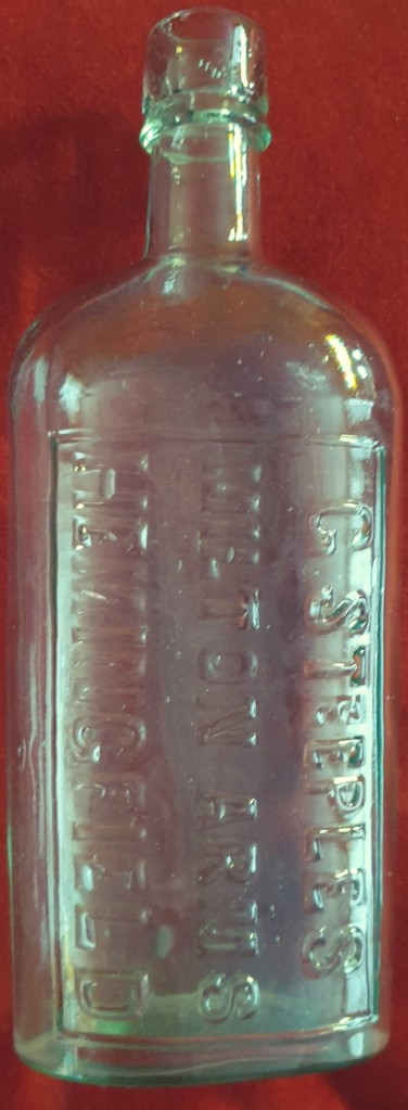 Image of whisky flask type glass bottle embossed with G Steeples, Milton Arms, Hemingfield